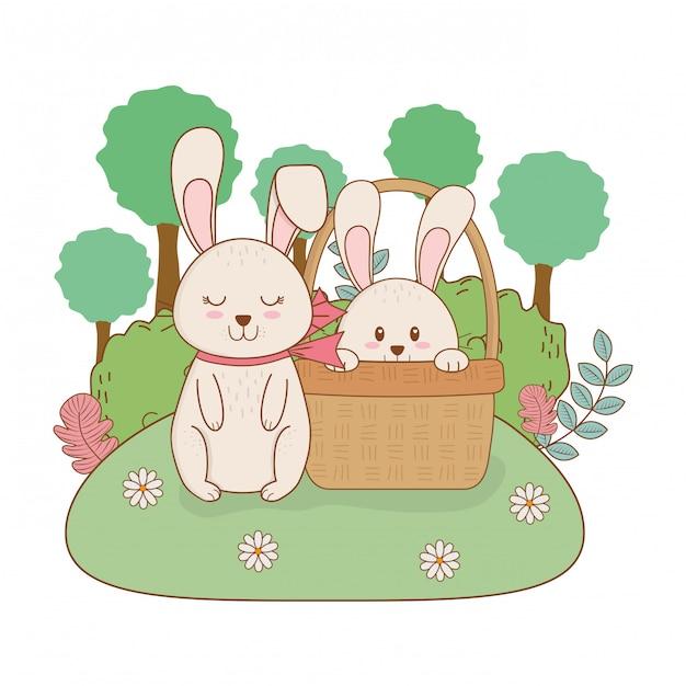 Petits lapins dans un panier sur le jardin Vecteur Premium