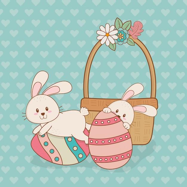 Petits lapins à l'oeuf peint des personnages de pâques Vecteur Premium