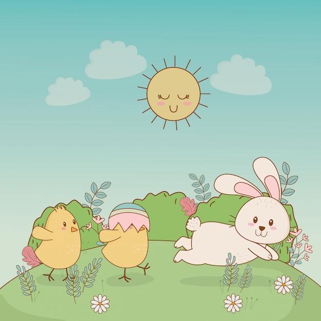 Petits poussins avec des personnages de pâques lapin Vecteur Premium