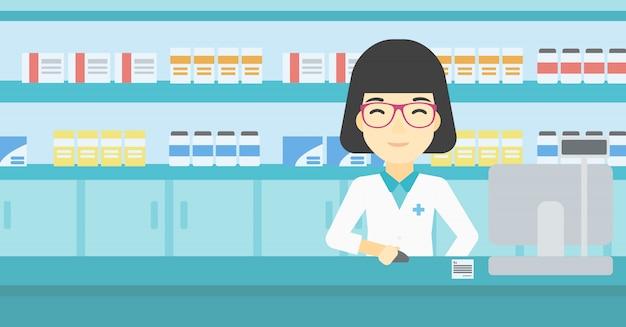 Pharmacien au comptoir avec écran d'ordinateur. Vecteur Premium