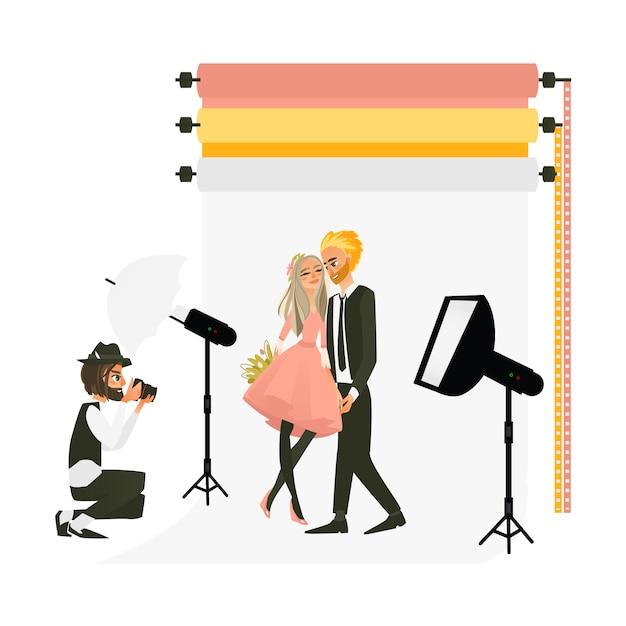 Photographe tournage d'un couple de mariage en studio Vecteur Premium