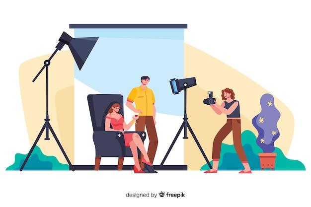 Photographes de dessins animés travaillant avec des modèles Vecteur gratuit