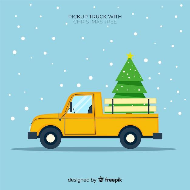 Pick-up transportant un arbre de noël Vecteur gratuit