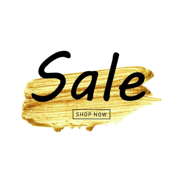 Pinceau or dessiné à la main et vente de texte. Vecteur Premium