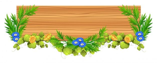 Planche de bois avec vigne et fleur Vecteur gratuit