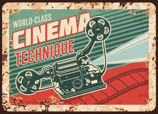Plaque De Métal Rouillé De Technique De Cinéma Avec Caméra Vidéo Vintage Et Bobines De Film Vecteur Premium