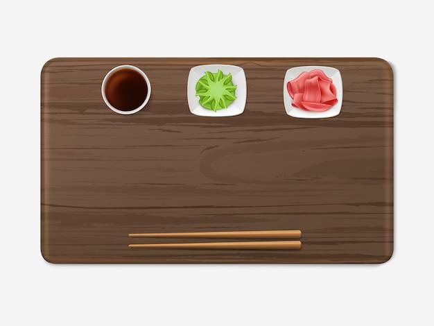 Plateau de sushi avec condiments mis en cuisine japonaise Vecteur gratuit
