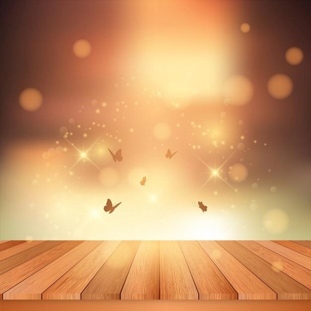 Platelage en bois donnant sur un ciel de coucher du soleil avec des papillons Vecteur gratuit