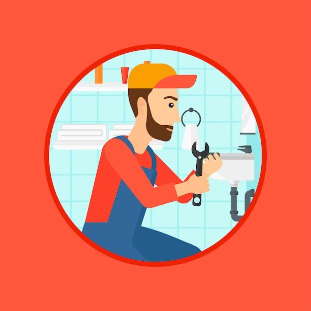 Plombier fixant le tuyau de l'évier avec une clé. Vecteur Premium