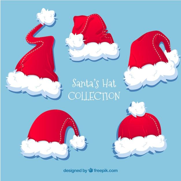 Plusieurs Chapeaux Du Père Noël Vecteur gratuit
