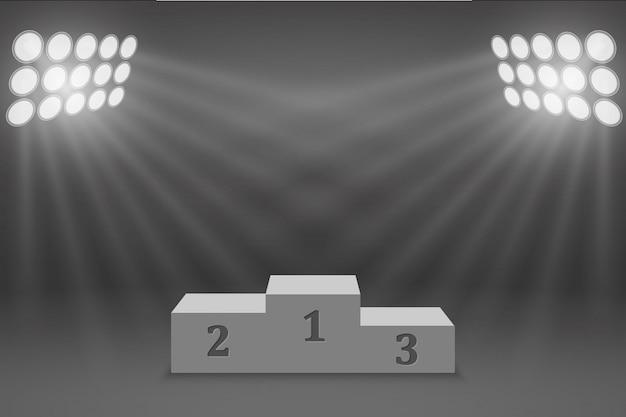Le podium sur podium du vainqueur sportif illuminé par des projecteurs Vecteur Premium