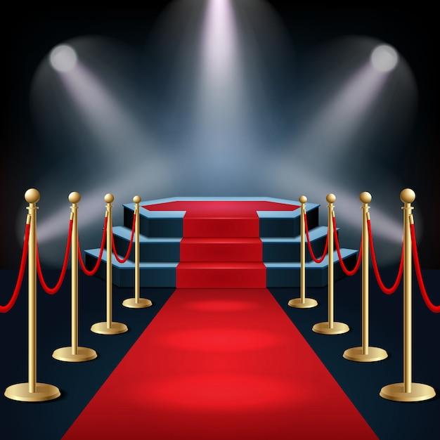 Podium avec tapis rouge et barrière de sécurité à la lueur des projecteurs Vecteur Premium