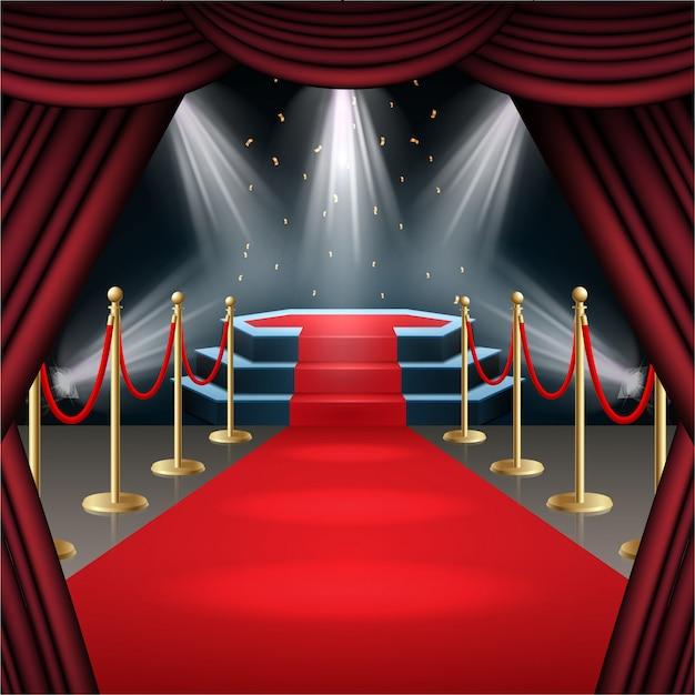 Podium avec tapis rouge et rideau à la lueur des projecteurs Vecteur Premium