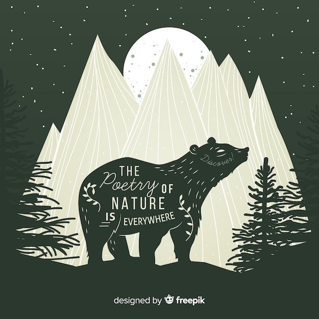 La Poésie De La Nature Est Partout. Lettrage Sur Un Ours Sauvage Dans Les Montagnes Vecteur gratuit