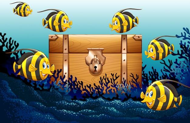 Poisson nageant sous l'océan Vecteur Premium