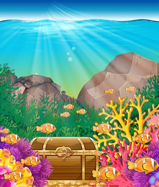 Poisson et poitrine sous l'océan Vecteur Premium