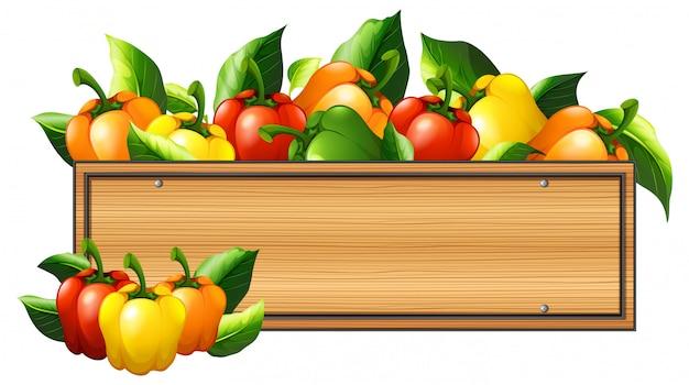 Poivrons et planche de bois Vecteur gratuit
