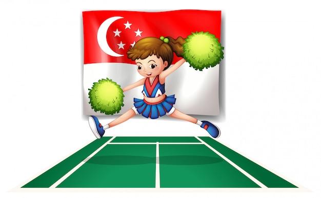 Une pom-pom girl aux pompons verts et le drapeau de singapour Vecteur Premium