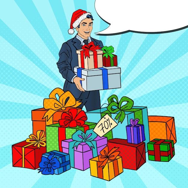 Pop Art Man In Santa Hat Avec Des Cadeaux En Vente De Noël. Vecteur Premium