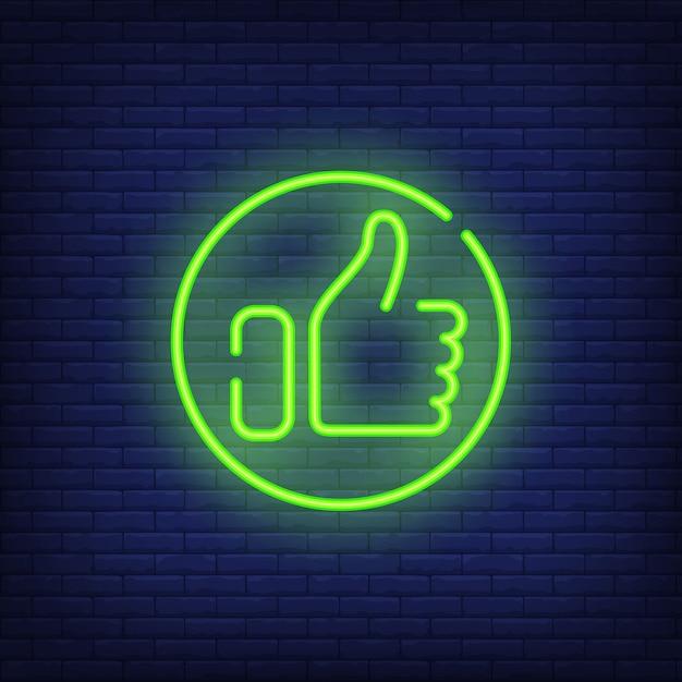 Pouce en haut signe au néon. main brillante montrant le pouce vers le haut en rond. Vecteur gratuit