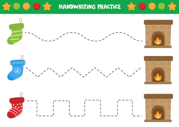 Pratique de l'écriture avec des chaussettes et une cheminée. Vecteur Premium