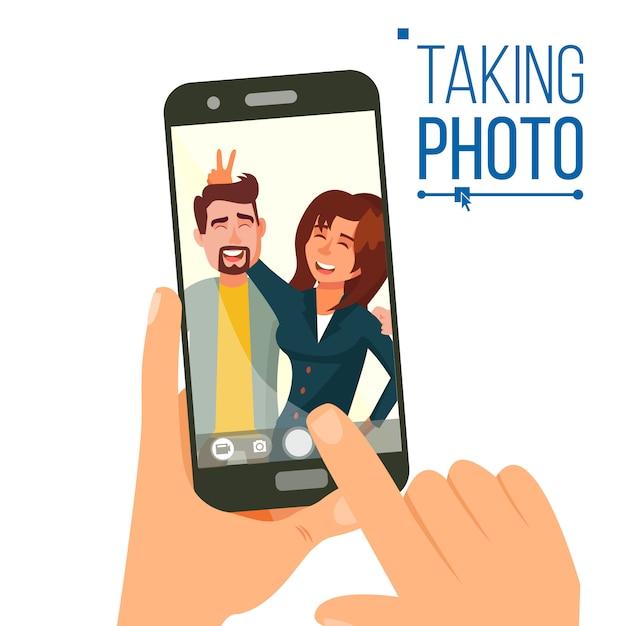 Prendre une photo sur smartphone Vecteur Premium