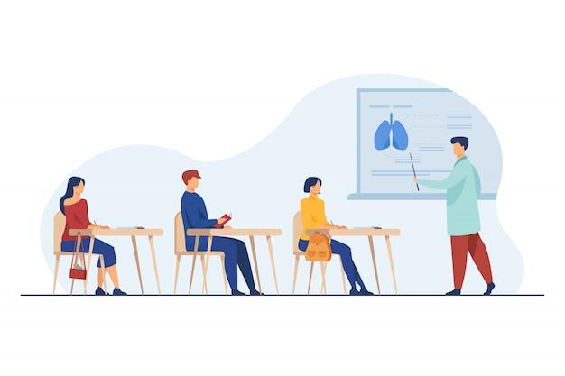 Professeur De Médecine Présentant Des Infographies D'organes Au Public Vecteur gratuit