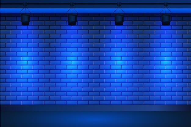 Projecteurs Sur Fond De Mur De Briques Bleues Vecteur gratuit
