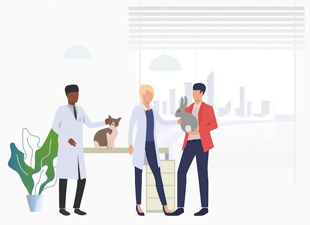 Propriétaire de chat et de lapin en visite chez le vétérinaire Vecteur gratuit