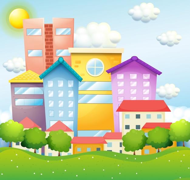 Quartier avec maisons et immeubles Vecteur gratuit