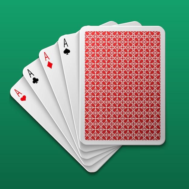 Quatre cartes de jeu de poker sur la table de jeu Vecteur Premium