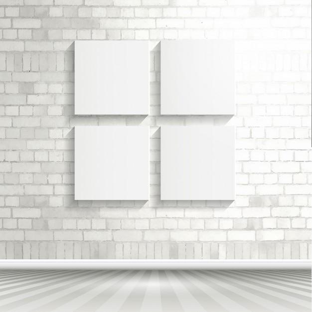 Quatre toiles vierges sur un mur de briques blanches Vecteur gratuit
