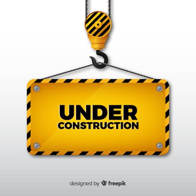 Réaliste sous fond de signe de construction Vecteur gratuit