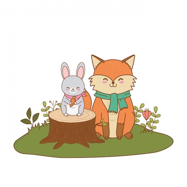 Renard mignon et lapin dans le champ des personnages forestiers Vecteur Premium