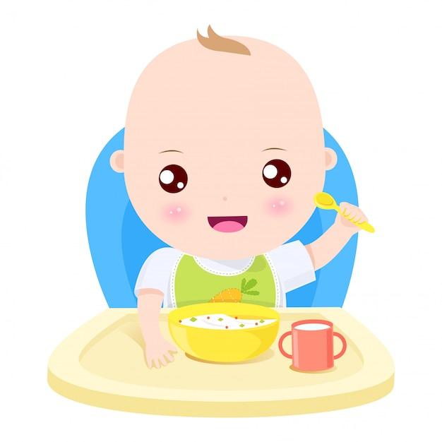Repas heureux bébé garçon Vecteur Premium