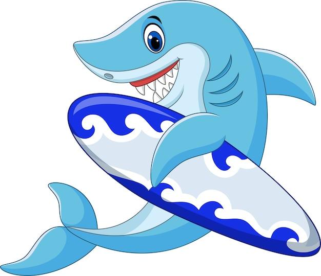Requin de dessin animé tenant la planche de surf Vecteur Premium