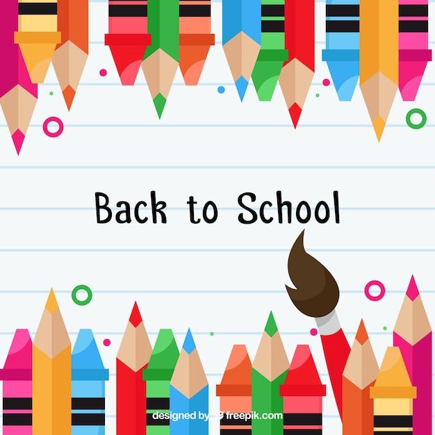 Retour à l'arrière-plan de l'école avec des crayons de couleur Vecteur gratuit