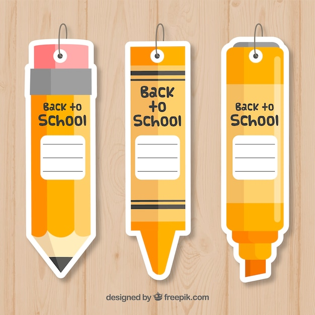 Retour aux étiquettes de l'école dans le style de crayon Vecteur gratuit