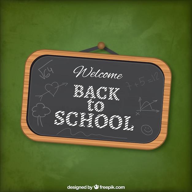Retour à lettrage sur le tableau noir de l'école Vecteur gratuit