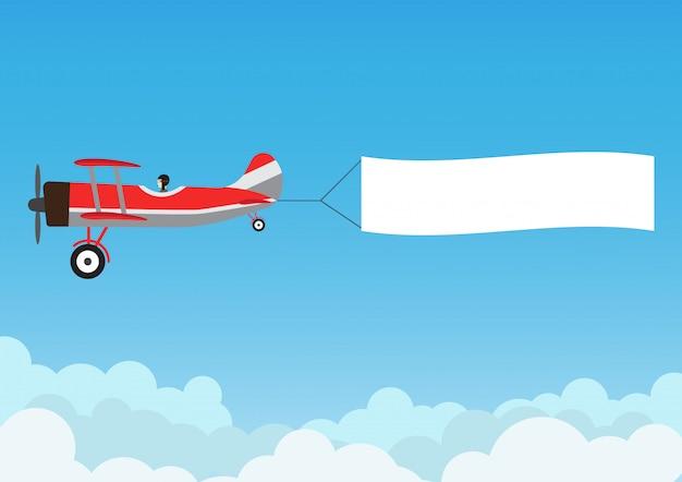 Rétro avion volant avec bannière publicitaire sur ciel bleu Vecteur Premium