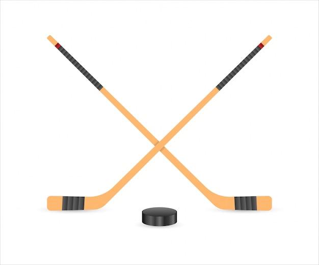 Rondelle Et Bâtons De Hockey Sur Glace. Vecteur Premium
