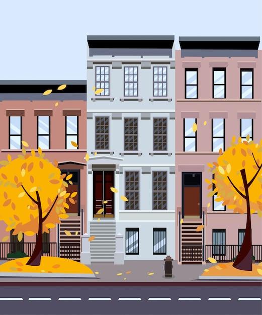 Rue de la ville d'automne. maisons de trois à quatre étages. paysage urbain de rue. paysage urbain avec arbres d'automne au premier plan Vecteur Premium