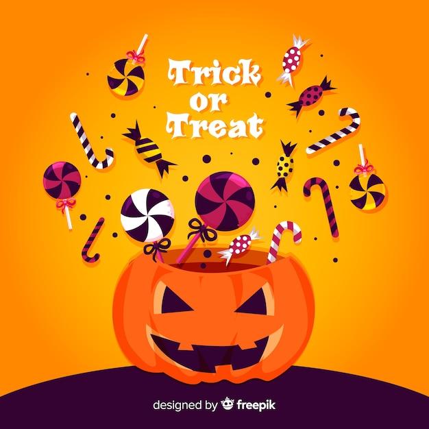 Sac de bonbons colorés de halloween avec un design plat Vecteur gratuit