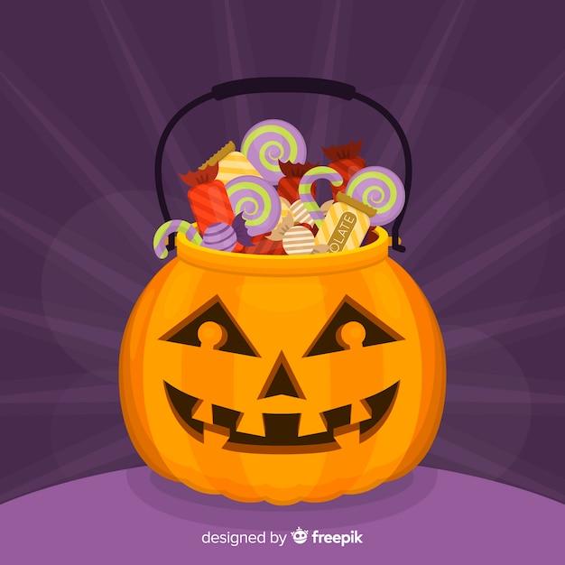 Sac citrouille rempli de bonbons pour halloween Vecteur gratuit