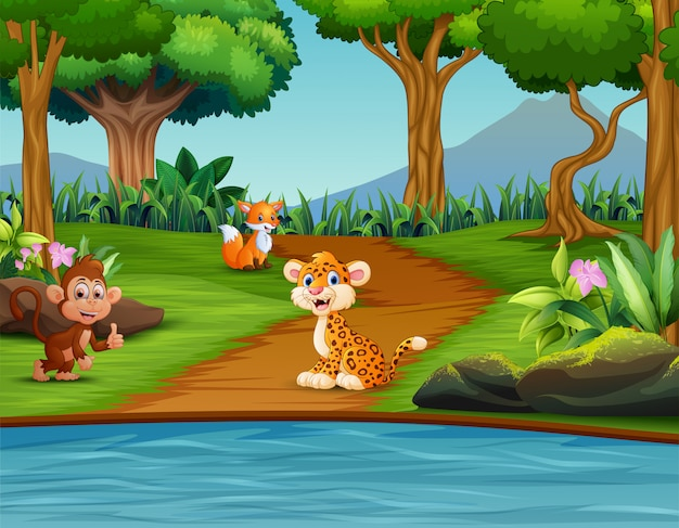 Scène de forêt avec différents animaux Vecteur Premium