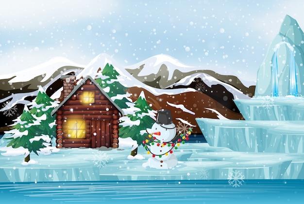 Scène De Noël Avec Bonhomme De Neige Et Chalet Vecteur gratuit