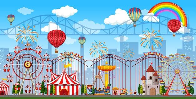 Scène De Parc D'attractions Pendant La Journée Avec Arc-en-ciel Et Ballons Dans Le Ciel Vecteur gratuit