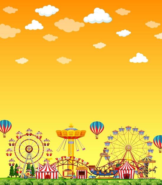 Scène De Parc D'attractions Pendant La Journée Avec Un Ciel Jaune Vierge Vecteur Premium