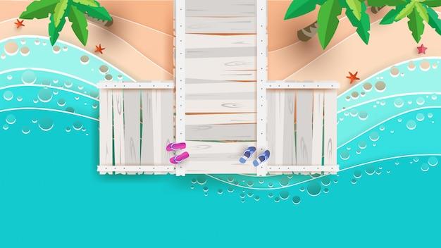 Scène de plage du haut en été avec des ponts en papier Vecteur Premium