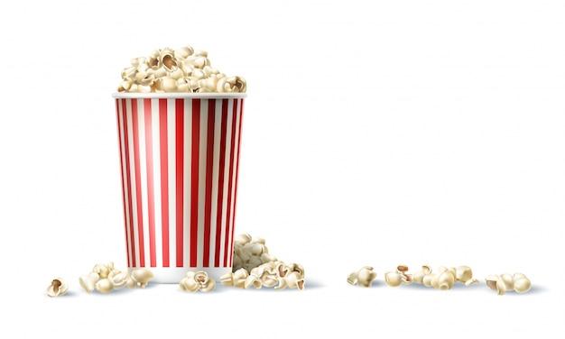 Seau de carton rouge et blanc avec du pop-corn en style réaliste Vecteur gratuit